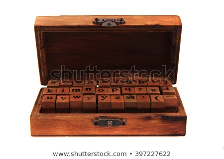 small alphabet from wooden hand printer stock photo © jonnysek