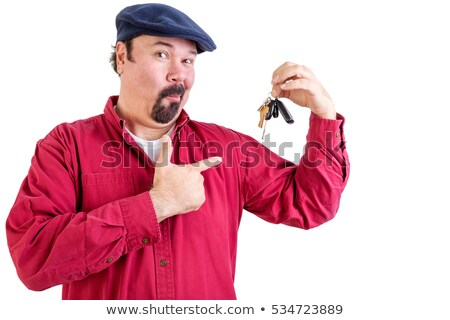 Proud man pointing to his new car keys Stock photo © ozgur