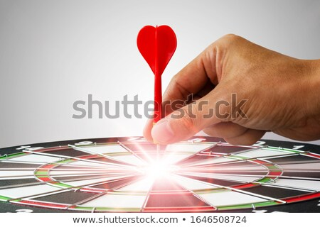 Archery target with red arrows in the center Stock photo © djmilic