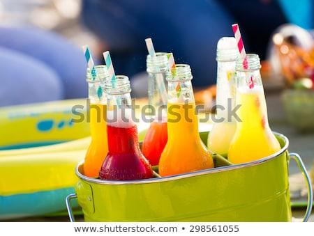 бутылок лимонад Постоянный красочный зеленый ковша Сток-фото © Yatsenko