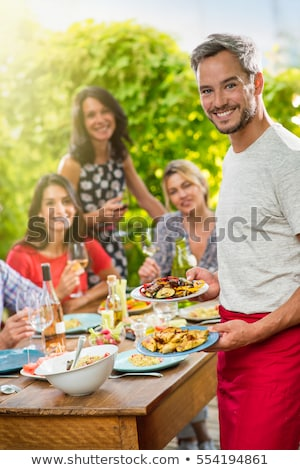 Serving with laugh. Stock photo © Fisher