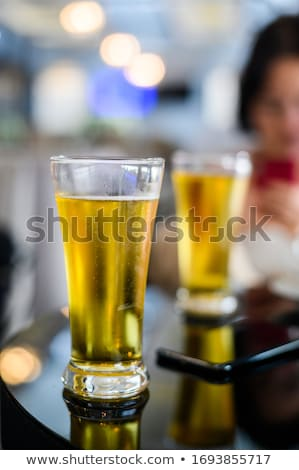 Man with mobile and dark beer mug Stock photo © stevanovicigor