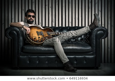 Portrait of a handsome performer holding a guitar stock photo © majdansky