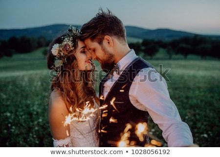 Stock photo: bride and groom illuminated by light