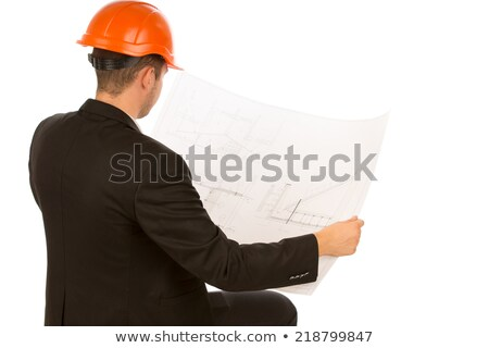 Man looking over blue prints Stock photo © IS2