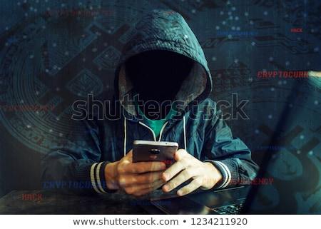 Cryptojacking concept, computer hacker with hoodie Stock photo © stevanovicigor