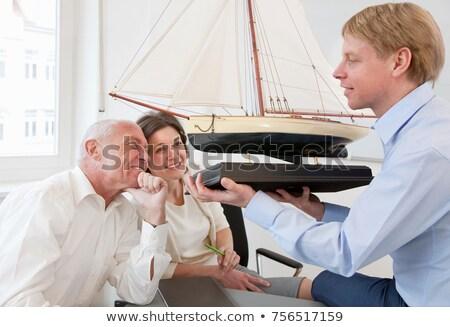 Patrząc model statku działalności kobieta Zdjęcia stock © IS2