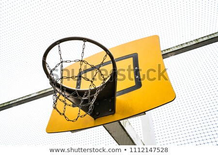 Basketball player dribbling on rooftop Stock photo © IS2