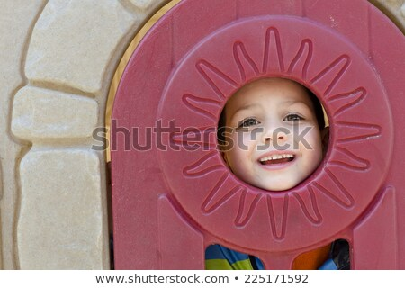 boy peeking through hole in playhouse stock photo © is2