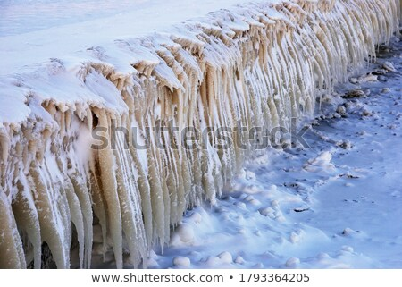 Row of frosty icicles in nature Stock photo © Juhku