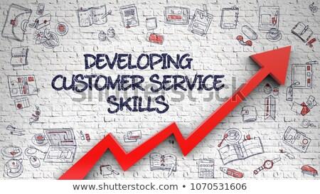 Developing Customer Service Skills on White Brick Wall. 3d Stock photo © tashatuvango