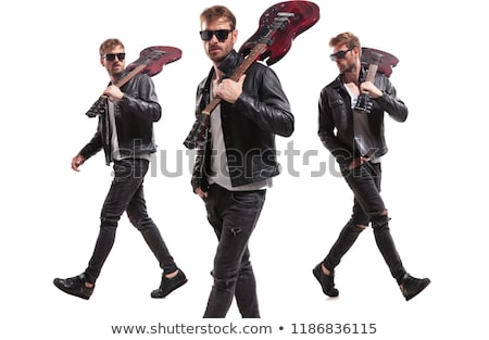 relaxed guitarist with sunglasses stepping to side stock photo © feedough
