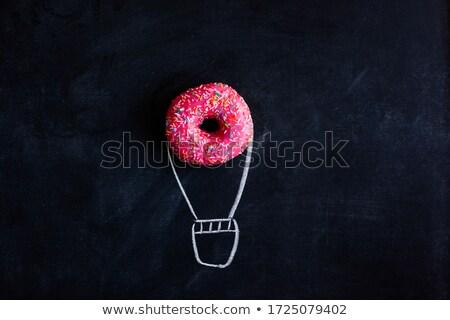 Black chalkboard with pink glazed donut stock photo © Melnyk