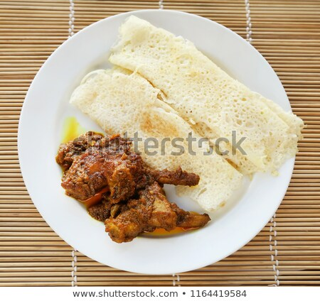 Chita ruti a Bengali cuisine with hot chicken curry Stock photo © bdspn