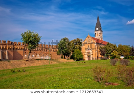 Town of Ilok defense walls and church view Stock photo © xbrchx