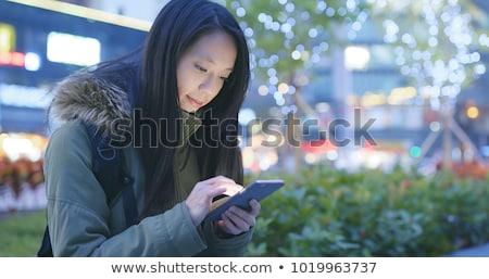 fiatal · üzletasszony · mobiltelefon · utca · irodaház · épület - stock fotó © boggy