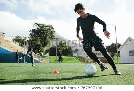 soccer player on fitness training footballers on practice stock photo © matimix