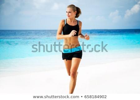 mulher · corrida · praia · esportes · mar · fitness - foto stock © bluering