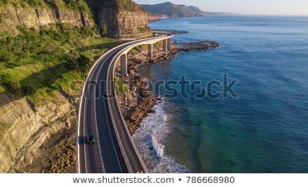 Sea Cliff Bridge and sunrise ocean Stock photo © lovleah