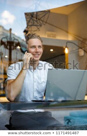 улыбаясь деловой человек говорить смартфон Сток-фото © deandrobot