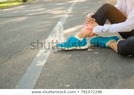 Jogger Having Pain In Her Knee Stock photo © AndreyPopov