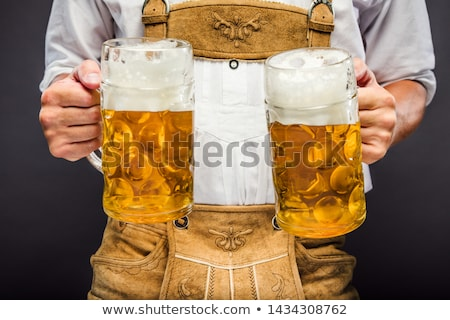 People enjoying food and drink in Bavarian beer garden Stock photo © Kzenon