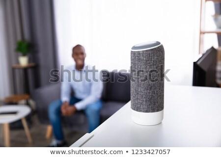 Hombre escuchar inalámbrica orador muebles primer plano Foto stock © AndreyPopov