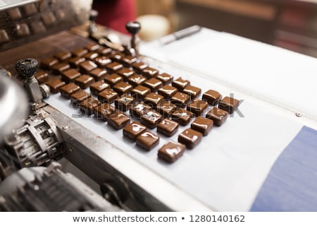 candies processing by chocolate coating machine Stock photo © dolgachov