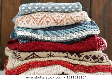 Warm cotton and woolen sweaters on top of each other prepared for cold season Stock photo © pressmaster