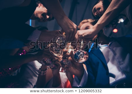Low angle view of friends toasting wine glass in night club Stock photo © wavebreak_media