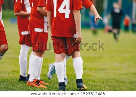 Jugadores banco viendo amateur torneo de fútbol juego Foto stock © matimix