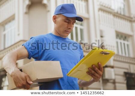Futár csomag vágólap város posta szolgáltatás Stock fotó © dolgachov
