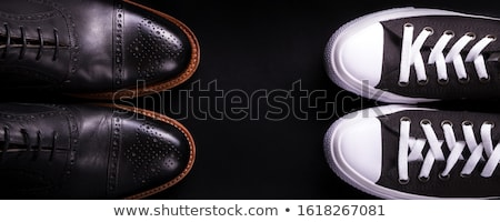 Banner with Mixed shoes. Oxford and sneakers shoe on black background. Stock photo © Illia