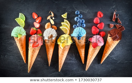 Set of ice-cream cone waffles with vanilla and fruity flavours Stock photo © LoopAll
