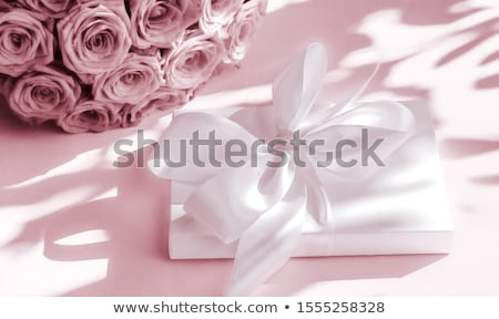 Luxury holiday silk gift box and bouquet of roses on blush pink  Stock photo © Anneleven