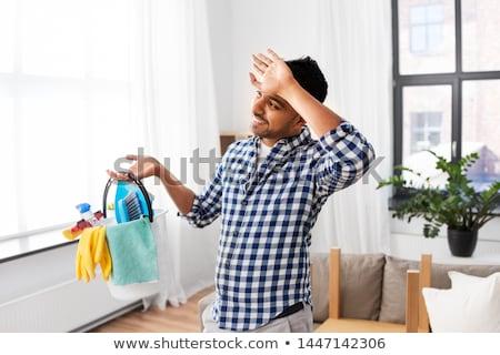 Fatigué homme seau nettoyage maison personnes Photo stock © dolgachov
