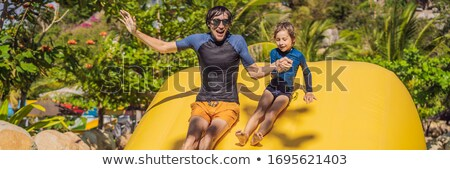 Pai filho inflável piscina bandeira Foto stock © galitskaya