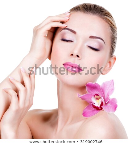 closeup on beautiful face with orchid flower stock photo © anna_om