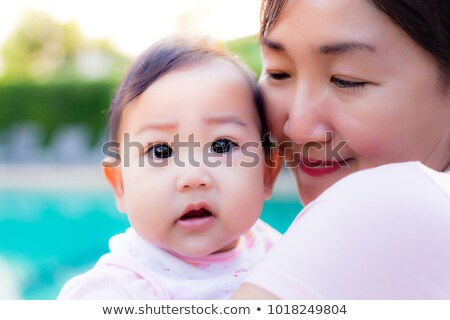 Curious mother carrying her daughter with big smile Stock photo © get4net