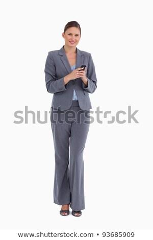 Tradeswoman using mobile phone Stock photo © photography33