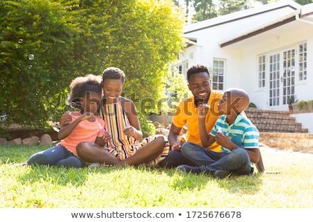 Család udvar otthon áll mosolyog néz Stock fotó © get4net