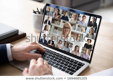 empresario · gafas · sesión · escritorio · mirando - foto stock © photography33