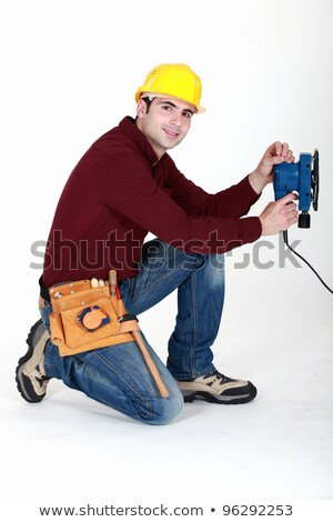 Carpenter saving time by using electric sander Stock photo © photography33