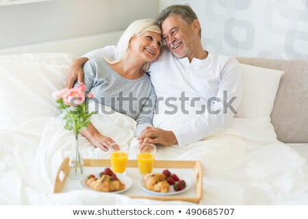 senior couple enjoying breakfast in bed stock photo © photography33