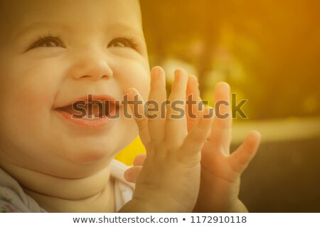 Little cheerful baby girl clap one's hands stock photo © Anna_Om