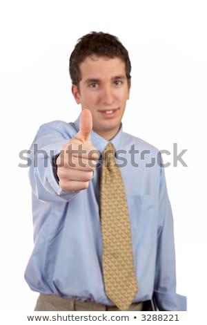 Smiling business man over a white background. Success gesture and selective focus on finger Stock photo © broker