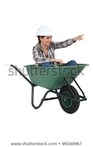 Female tradesperson sitting in a wheelbarrow Stock photo © photography33