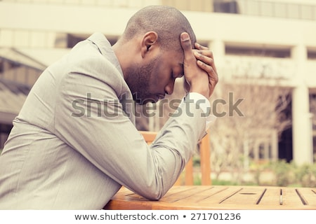 tensed young businessman with hand on the face Stock photo © feedough