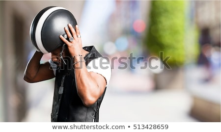 Motorcyclist wearing black jacket and helmet Stock photo © photography33
