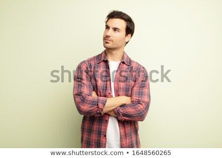 elegant young handsome man looking away stock photo © victoria_andreas